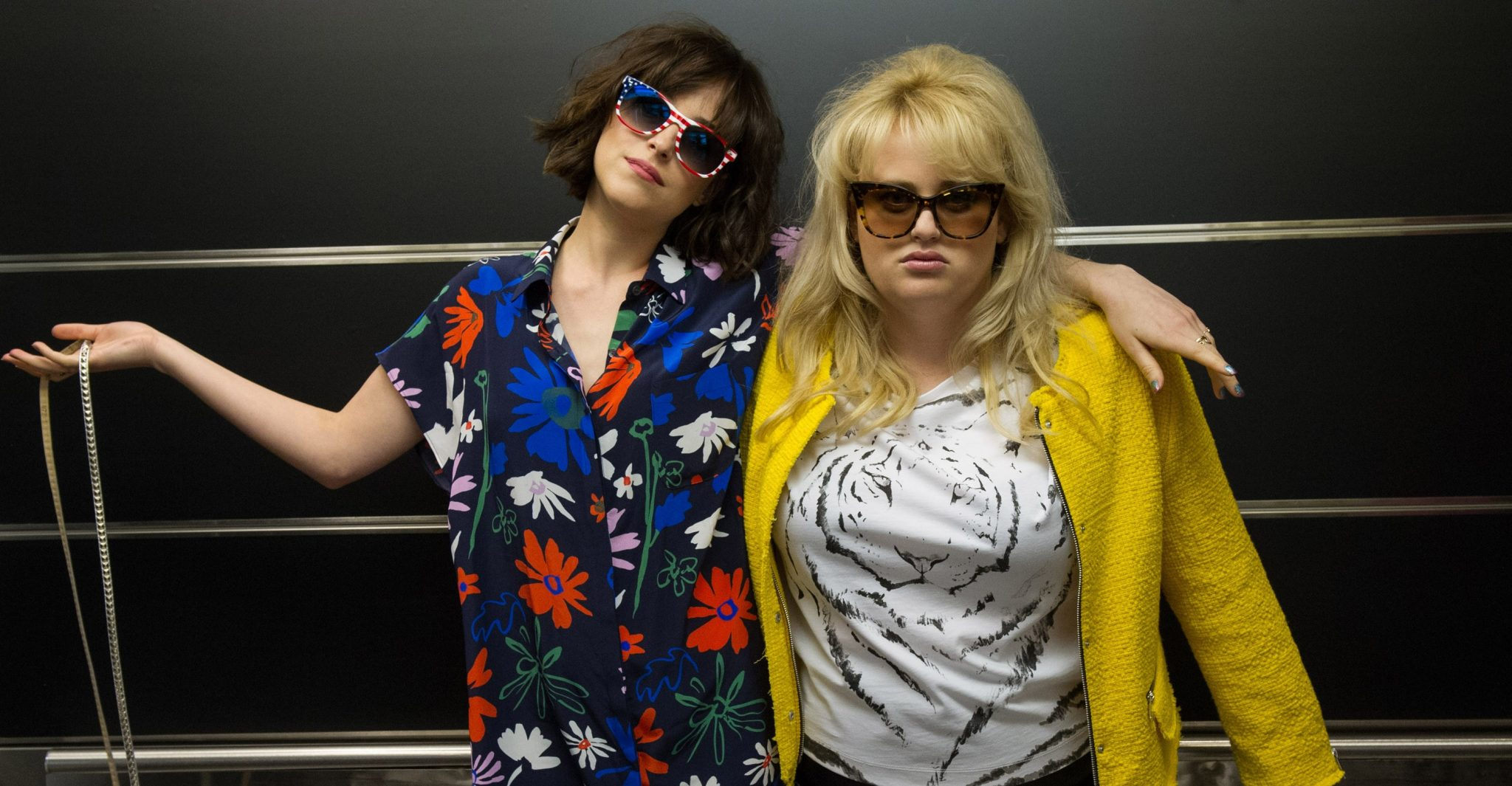 "This image released by  Warner Bros. Entertainment Inc. shows Dakota Johnson, left, and Rebel Wilson in a scene from, ""How to Be Single."" (Barry Wetcher/Warner Bros. Entertainment via AP) Inc."