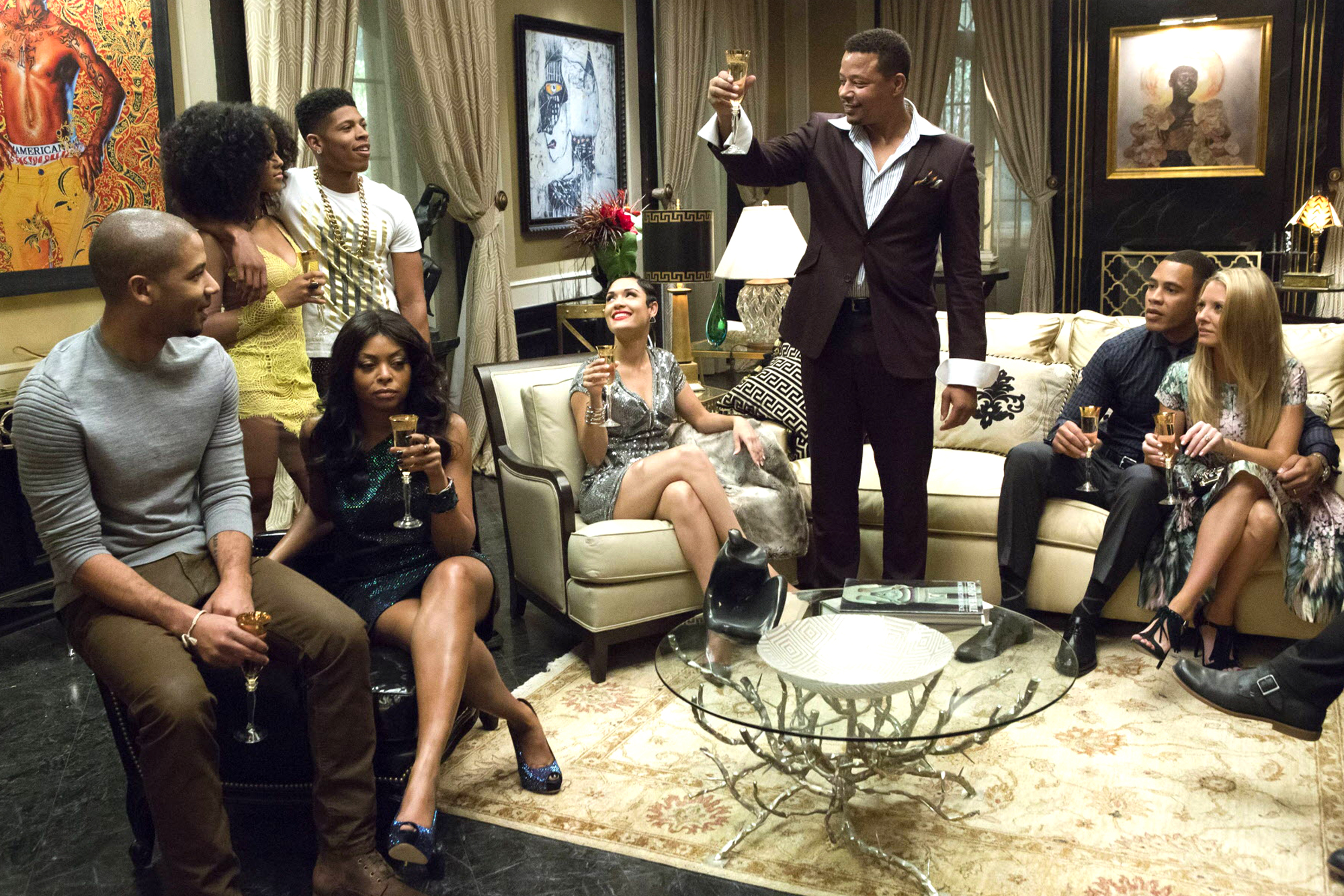 """TV STILL -- DO NOT PURGE -- EMPIRE: Lucious (Terrence Howard) toasts his family in the """"Devil Quotes Scripture"""" episode airing Wednesday, Jan. 21 (9:00-10:00 PM ET/PT) on FOX. Pictured L-R: Jussie Smollett, Serayah McNeill, Taraji P. Henson, Bryshere Gray, Grace Gealey, Terrence Howard, Trai Byers and Kaitlin Doubleday. ¨©2014 Fox Broadcasting Co. CR: Chuck Hodes/FOX"""