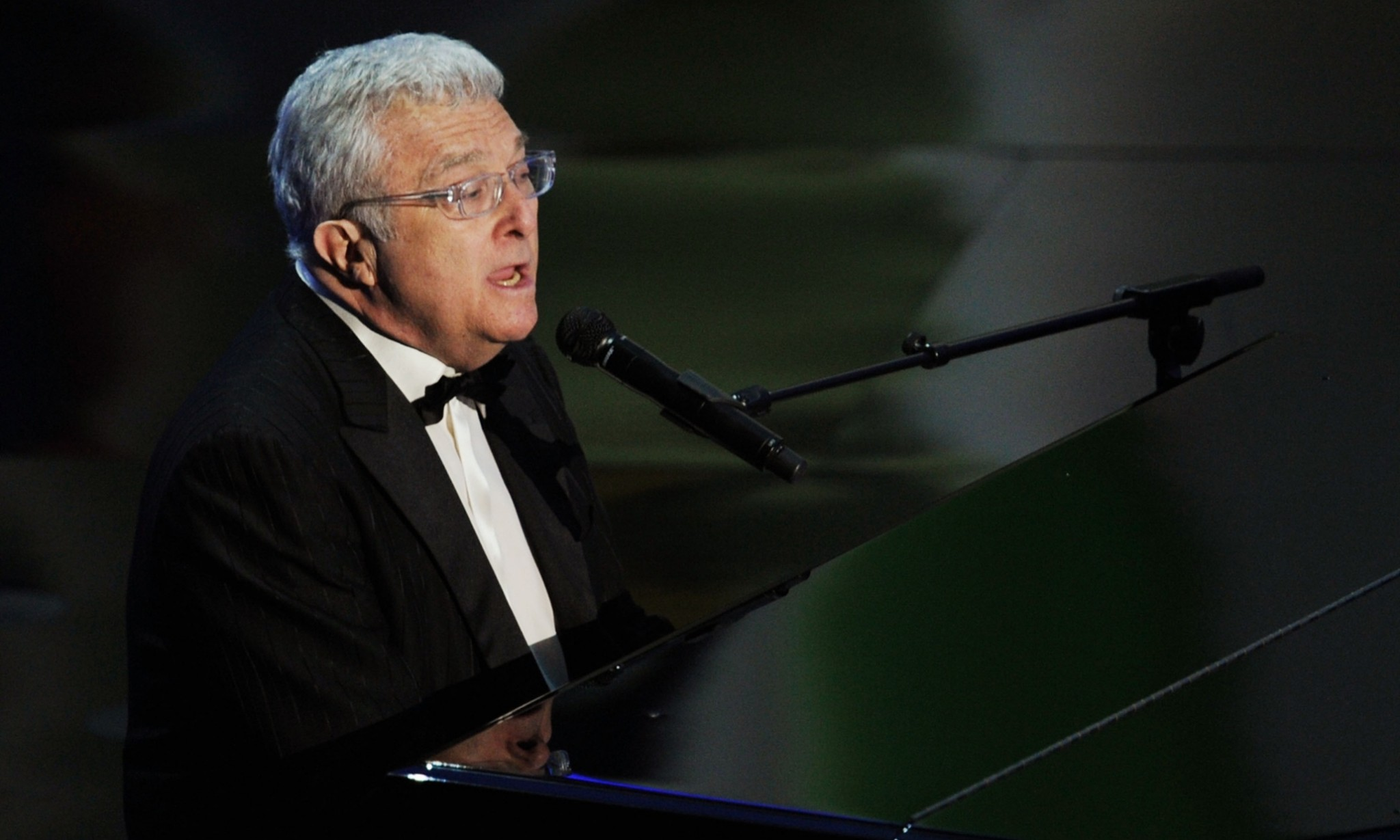 HOLLYWOOD, CA - FEBRUARY 27: Musician Randy Newman performs the Best Achievement in Music Written for Motion Pictures, Original Song nominee 'We Belong Together' from the motion picture 'Toy Story 3' onstage during the 83rd Annual Academy Awards held at the Kodak Theatre on February 27, 2011 in Hollywood, California. (Photo by Kevin Winter/Getty Images)