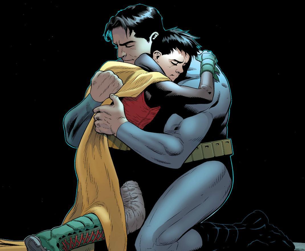 Batman and Robin embracing in the DC comics.