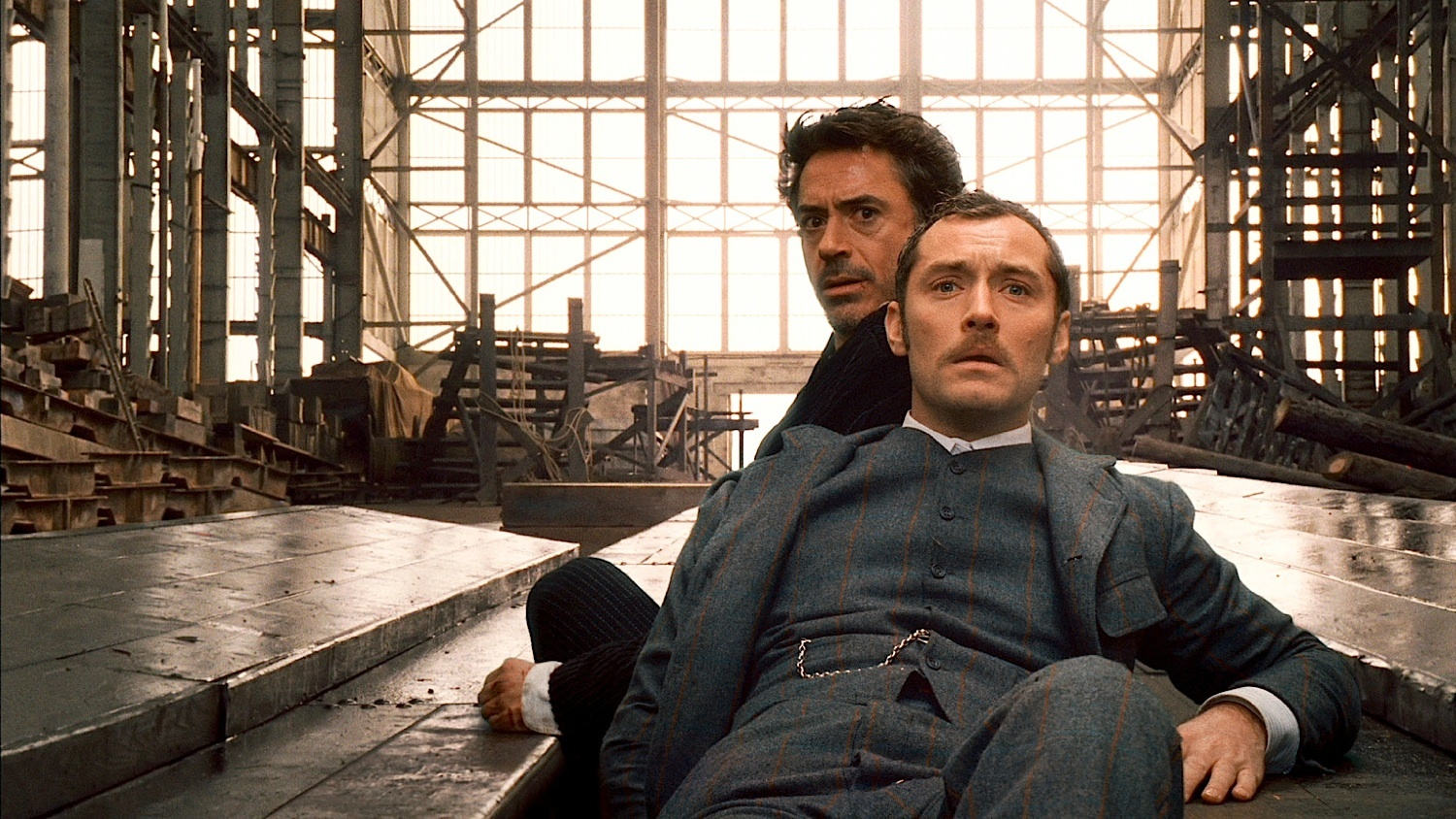 """SHH-SWTP-148 (L-r) ROBERT DOWNEY JR. as Sherlock Holmes and JUDE LAW as Dr. John Watson in Warner Bros. Pictures' and Village Roadshow Pictures' action-adventure mystery """"Sherlock Holmes,"""" distributed by Warner Bros. Pictures."""