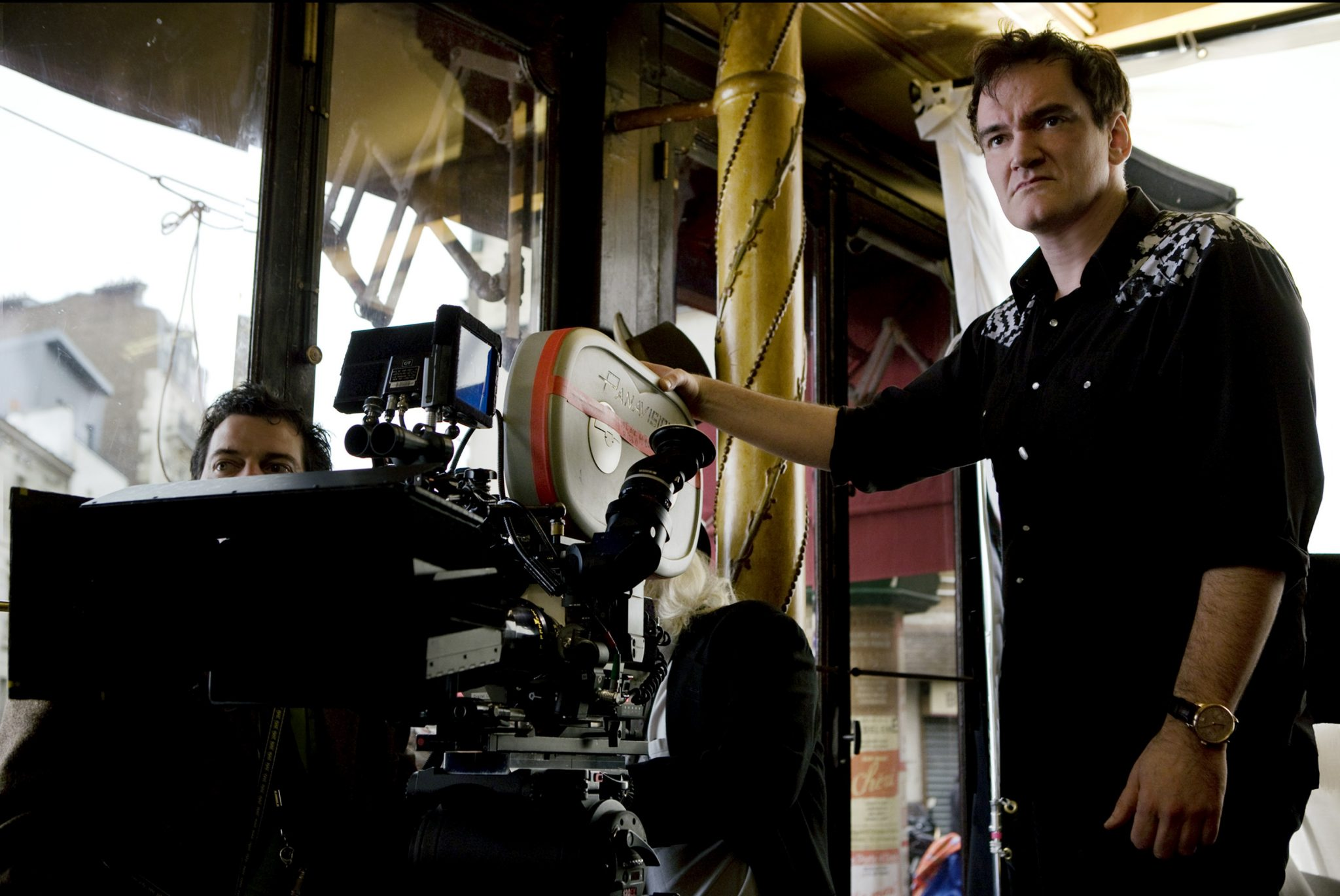 "In this film publicity image released by The Weinstein Co., director Quentin Tarantino is shown on the set of, ""Inglourious Basterds.""  Tarantino was nominated Tuesday, Feb. 2, 2010 for an Oscar for best director for, ""Inglourious Basterds."" The 82nd Academy Awards will be presented on March 7. (AP Photo/The Weinstein Co., Francois Duhamel)"