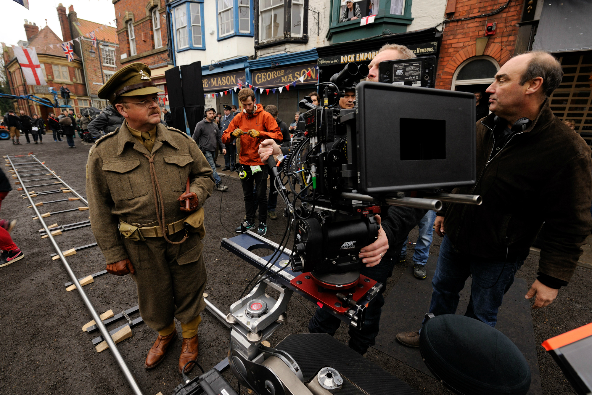 Oliver Parker directing Toby Jones on set.