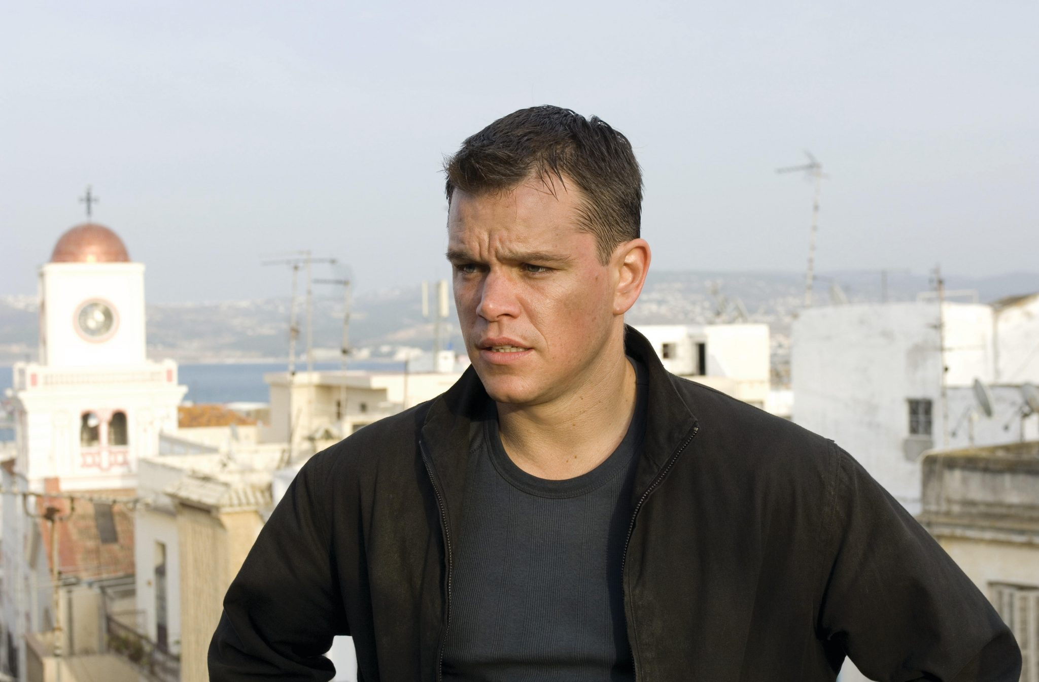 Jason Bourne (MATT DAMON) surveys his quarry in Tangier in the espionage thriller that takes Bourne back home: ?The Bourne Ultimatum?.