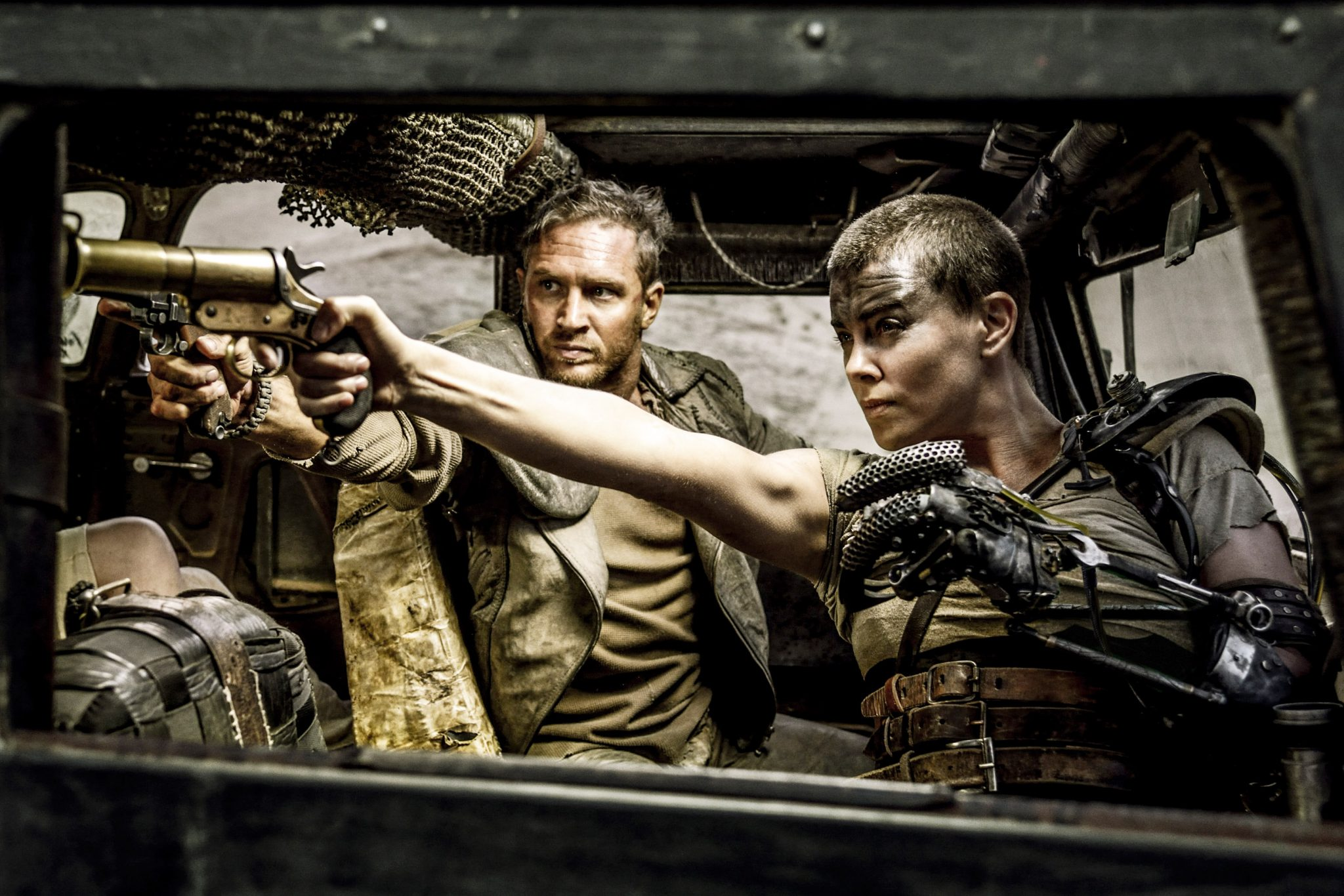 MAD MAX: FURY ROAD - 2015 FILM STILL - CHARLIZE THERON as Furiosa and    Photo Credit: Jasin Boland  © 2015 WV FILMS IV LLC AND RATPAC-DUNE ENTERTAINMENT LLC - U.S., CANADA, BAHAMAS & BERMUDA  © 2015 VILLAGE ROADSHOW FILMS (BVI) LIMITED - ALL OTHER TERRITORIES