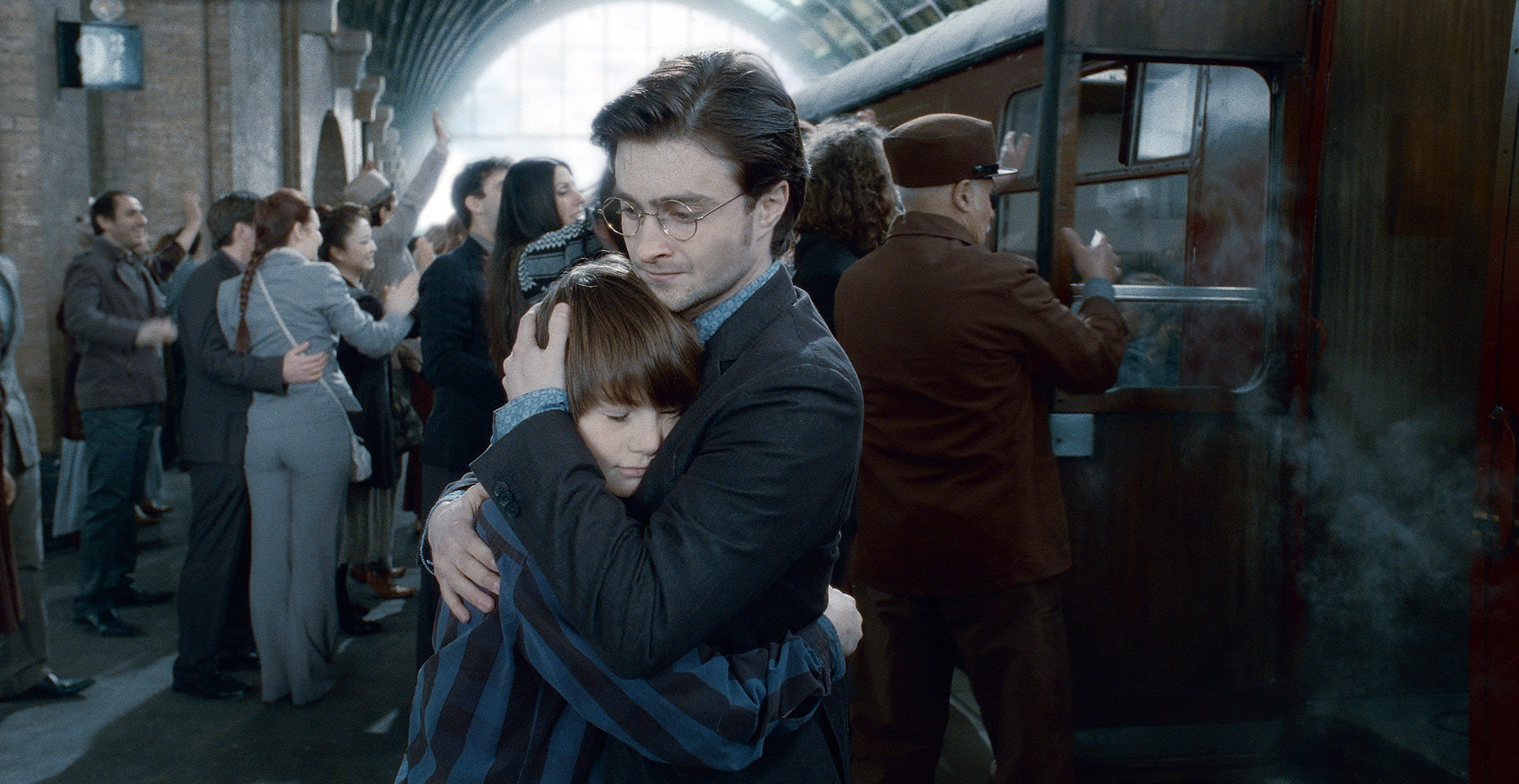 """SUNDAY CALENDAR AUGUST 7, 2011. DO NOT USE PRIOR TO PUBLICATION ******************** ARTHUR BOWEN as Albus Severus Potter (19 years later)  and DANIEL RADCLIFFE as Harry Potter in Warner Bros. Pictures' fantasy adventure movie """"HARRY POTTER AND THE DEATHLY HALLOWS - PART 2,"""" a Warner Bros. Pictures release. Photo courtesy of Warner Bros. Pictures"""