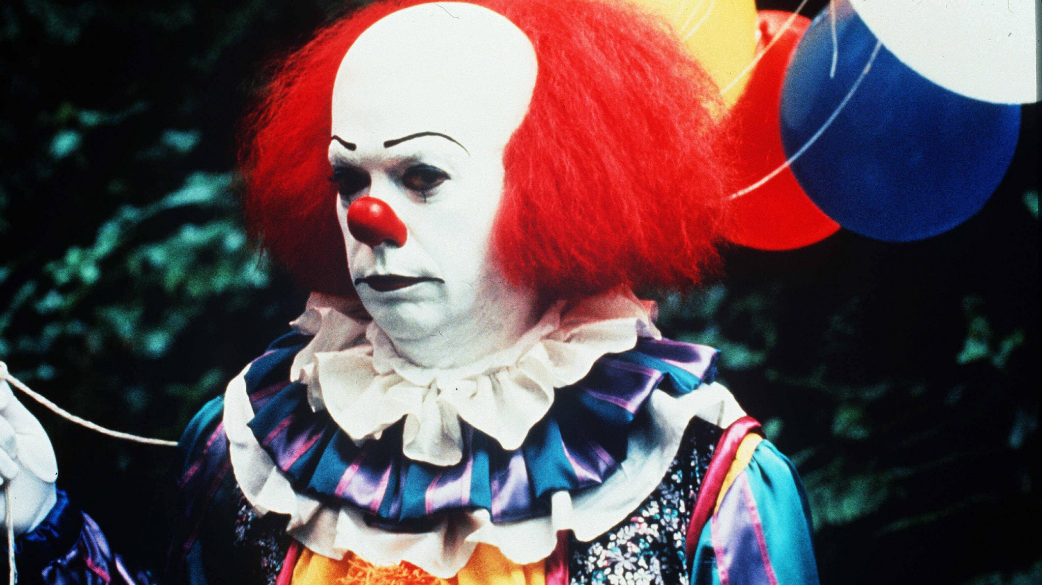 Tim Curry as Pennywise in a 1990 TV adaptation of Stephen King's It. Come on, tell us you aren't just a little creeped out.